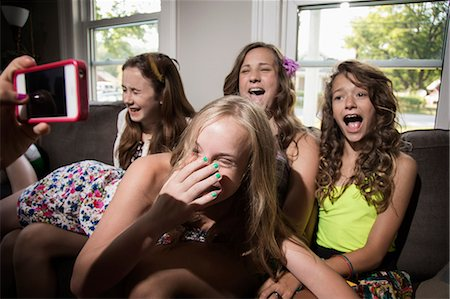 preteen girls faces photo - Group of girls being photographed with camera phone Stock Photo - Premium Royalty-Free, Code: 614-06402696