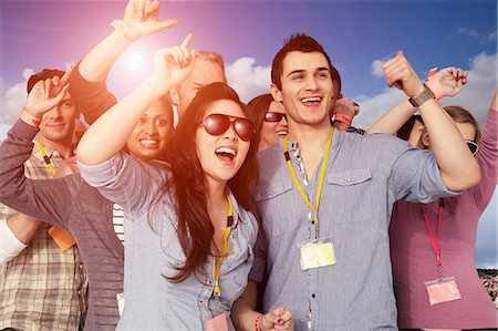 event - People cheering at a music festival Stock Photo - Premium Royalty-Free, Code: 614-06402708