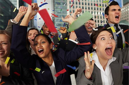 people falling - Businesspeople cheering as ticker tape falls Stock Photo - Premium Royalty-Free, Code: 614-06402721