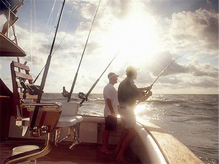 fishing - Men fishing from sport fishing boat Stock Photo - Premium Royalty-Free, Code: 614-06402872