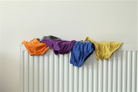 four - Underwear drying on radiator Stock Photo - Premium Royalty-Free, Code: 614-06402954