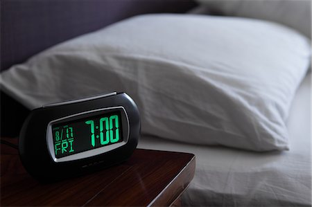 Alarm clock by bed Stock Photo - Premium Royalty-Free, Code: 614-06402973