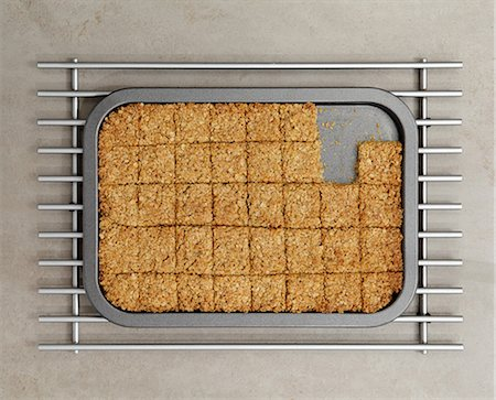 snack - Tray of flapjacks with some missing Stock Photo - Premium Royalty-Free, Code: 614-06402984