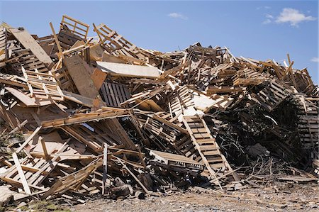 Pile of discarded wood at waste management site Stock Photo - Premium Royalty-Free, Code: 614-06403008
