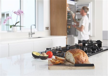 fridge - Man in kitchen, preparing food Stock Photo - Premium Royalty-Free, Code: 614-06403000