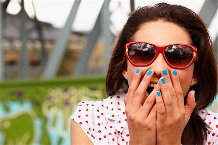 Teenage girl in sunglasses, looking shocked Stock Photo - Premium Royalty-Free, Code: 614-06403040