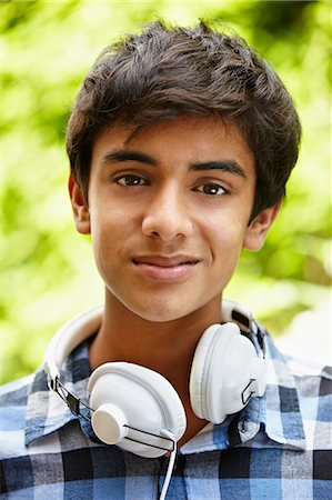 east indian (male) - Portrait of teenage boy with headphones Stock Photo - Premium Royalty-Free, Code: 614-06403067
