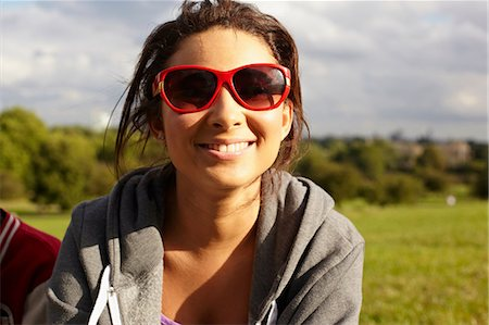 Teenage girl in sunglasses in the park Stock Photo - Premium Royalty-Free, Code: 614-06403085