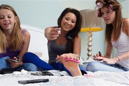 Teenage girls painting toenails Stock Photo - Premium Royalty-Free, Code: 614-06403095
