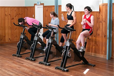 funny looking people - Exhausted woman in spinning class Stock Photo - Premium Royalty-Free, Code: 614-06403126