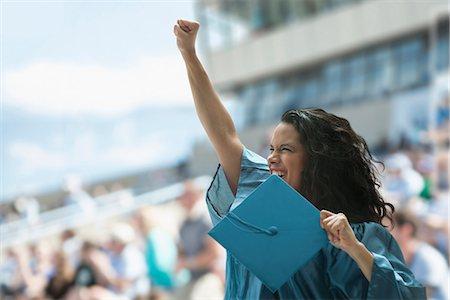 Female graduate raising fist Stock Photo - Premium Royalty-Free, Code: 614-06442275