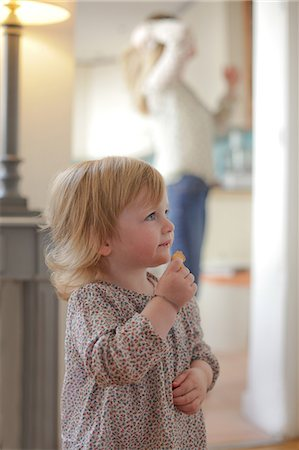 Portrait of toddler eating snack Stock Photo - Premium Royalty-Free, Code: 614-06442288