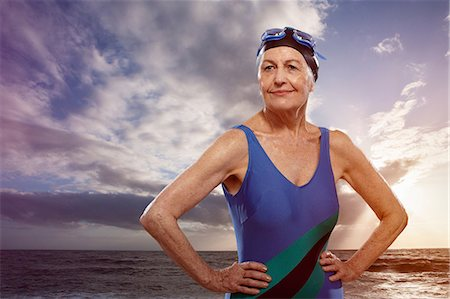 Senior woman wearing swimsuit with hands on hips Stock Photo - Premium Royalty-Free, Code: 614-06442309