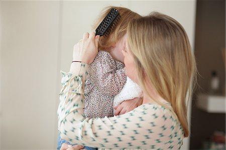 Mother brushing daughters hair Stock Photo - Premium Royalty-Free, Code: 614-06442302