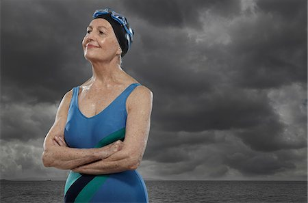 Senior woman wearing swimsuit with arms folded Stock Photo - Premium Royalty-Free, Code: 614-06442310