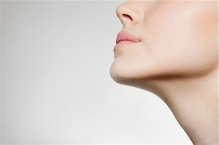 Womans jaw, low angle Stock Photo - Premium Royalty-Free, Code: 614-06442324