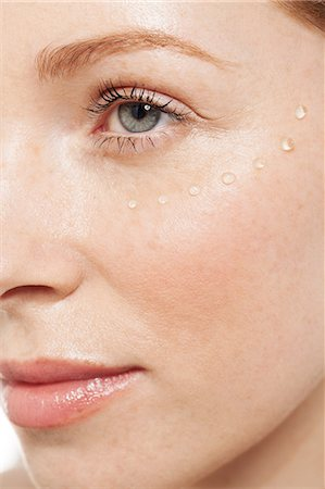 Woman with eye gel on her face Stock Photo - Premium Royalty-Free, Code: 614-06442379