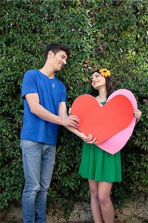 Couple holding heart shape Stock Photo - Premium Royalty-Free, Code: 614-06442419