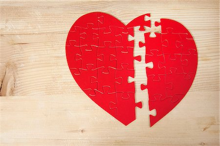Heart shaped jigsaw puzzle Stock Photo - Premium Royalty-Free, Code: 614-06442445
