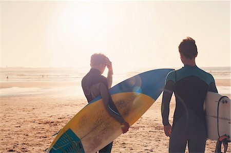 portugal - Surfers looking out towards sea Stock Photo - Premium Royalty-Free, Code: 614-06442472