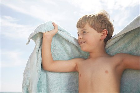 Boy outdoors with a towel Stock Photo - Premium Royalty-Free, Code: 614-06442487