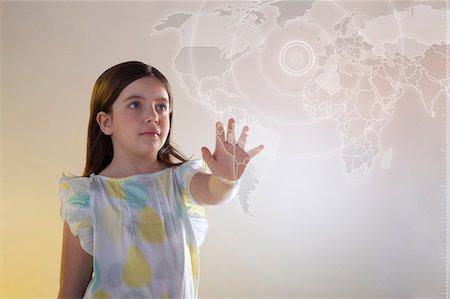 female hand - Girl touching virtual world map Stock Photo - Premium Royalty-Free, Code: 614-06442508