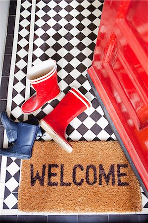 Welcome mat and wellington boots Stock Photo - Premium Royalty-Free, Code: 614-06442516