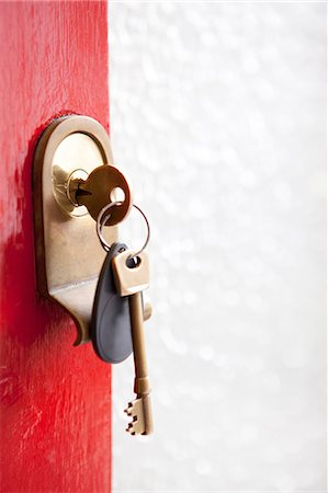 Close up of house keys in front door Stock Photo - Premium Royalty-Free, Code: 614-06442537