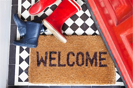 Welcome mat and wellington boots Stock Photo - Premium Royalty-Free, Code: 614-06442542