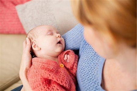 Mother holding newborn daughter Stock Photo - Premium Royalty-Free, Code: 614-06442569