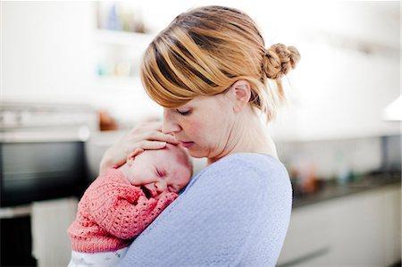 Mother holding newborn daughter Stock Photo - Premium Royalty-Free, Code: 614-06442570