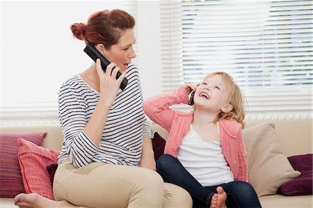 Mother and daughter on cell phones Stock Photo - Premium Royalty-Free, Code: 614-06442586
