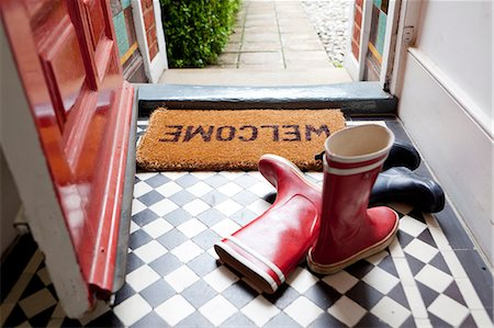 red - Welcome mat and wellington boots Stock Photo - Premium Royalty-Free, Code: 614-06442580