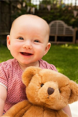 Happy baby girl with teddy bear Stock Photo - Premium Royalty-Free, Code: 614-06442658