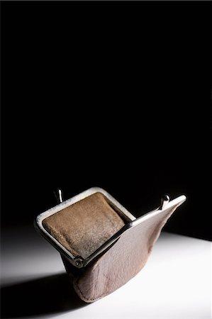 Empty purse Stock Photo - Premium Royalty-Free, Code: 614-06442715