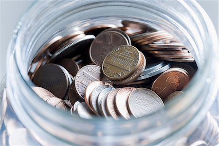 Cent coins in a jar Stock Photo - Premium Royalty-Free, Code: 614-06442719
