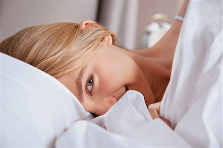 Close up of young woman in bed Stock Photo - Premium Royalty-Free, Code: 614-06442721
