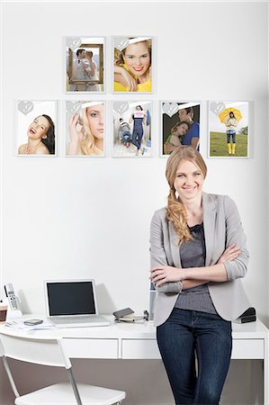 poster - Confident young woman in magazine office Stock Photo - Premium Royalty-Free, Code: 614-06442777