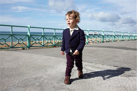 Little boy walking promenade in mod clothing Stock Photo - Premium Royalty-Free, Code: 614-06442796