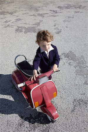 Little boy with red scooter Stock Photo - Premium Royalty-Free, Code: 614-06442793