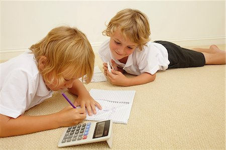Two schoolboys doing homework Stock Photo - Premium Royalty-Free, Code: 614-06442826