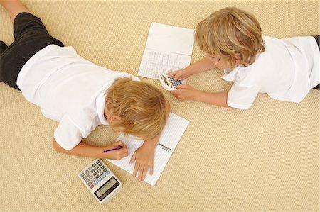 Two schoolboys doing homework Stock Photo - Premium Royalty-Free, Code: 614-06442827