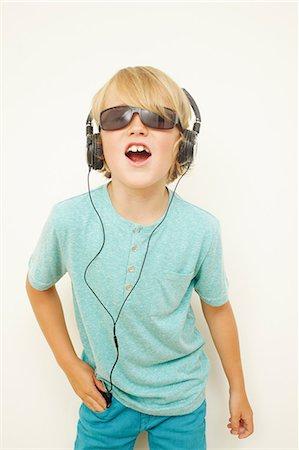 Boy wearing headphones and sunglasses Stock Photo - Premium Royalty-Free, Code: 614-06442820