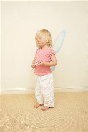 dress up girl - Toddler wearing wings, holding wand Stock Photo - Premium Royalty-Free, Code: 614-06442833