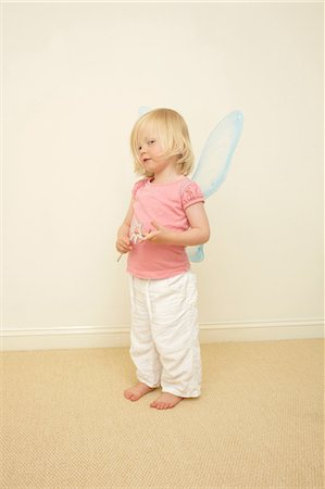 dress up girl - Toddler wearing wings, holding wand Stock Photo - Premium Royalty-Free, Code: 614-06442833