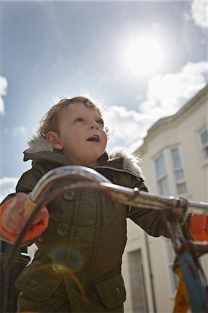 Mod toddler boy on retro bicycle Stock Photo - Premium Royalty-Free, Code: 614-06442851