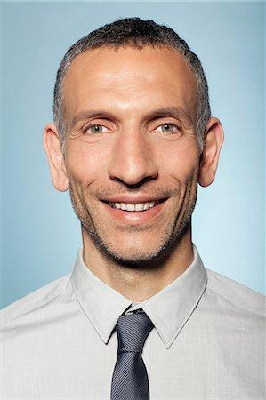 portrait smile caucasian one - Portrait of man smiling Stock Photo - Premium Royalty-Free, Code: 614-06442869