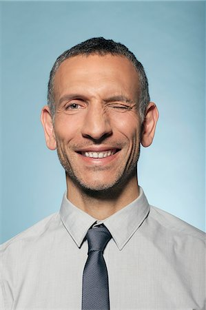 portrait smile caucasian one - Man winking Stock Photo - Premium Royalty-Free, Code: 614-06442871