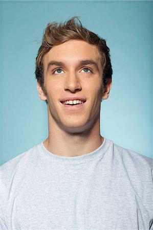 portrait smile caucasian one - Portrait of man looking up Stock Photo - Premium Royalty-Free, Code: 614-06442898