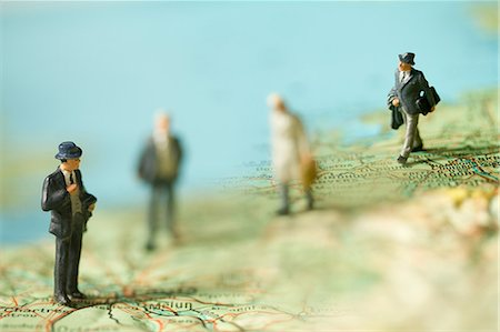 Miniature businessmen on a map Stock Photo - Premium Royalty-Free, Code: 614-06442947